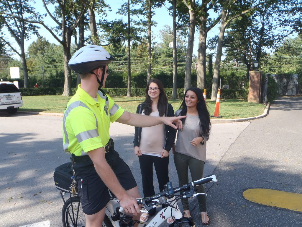 Bike Patrol Officer Speaking with Students on campus